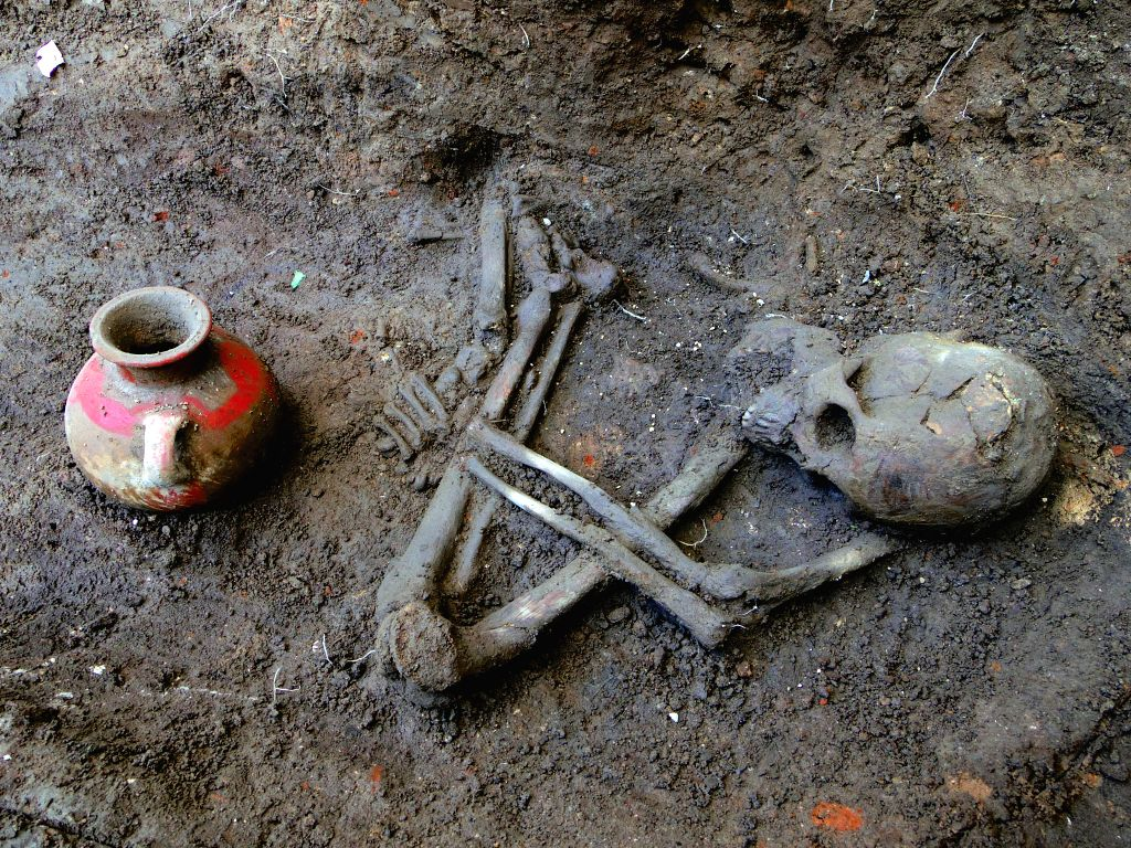 Undated image provided on July 4, 2014 by the Secretariat of Culture of El Salvador shows one of the three human skeletons of more than 1,600 years old found in  ...