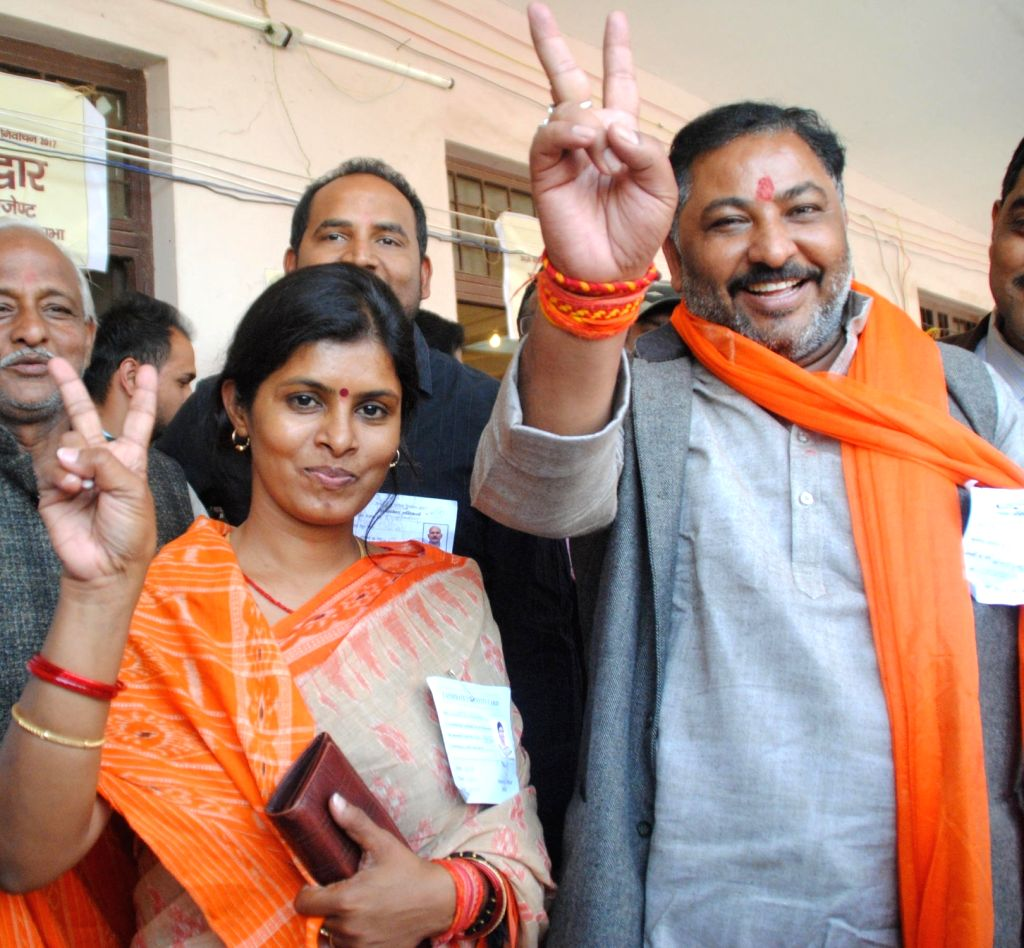 Uttar Pradesh BJP leader Daya Shankar Singh with his wife and MLA Swati Singh celebrates as his suspension was revoked by BJP in Lucknow on March 12, 2017. - Daya Shankar Singh and Swati Singh