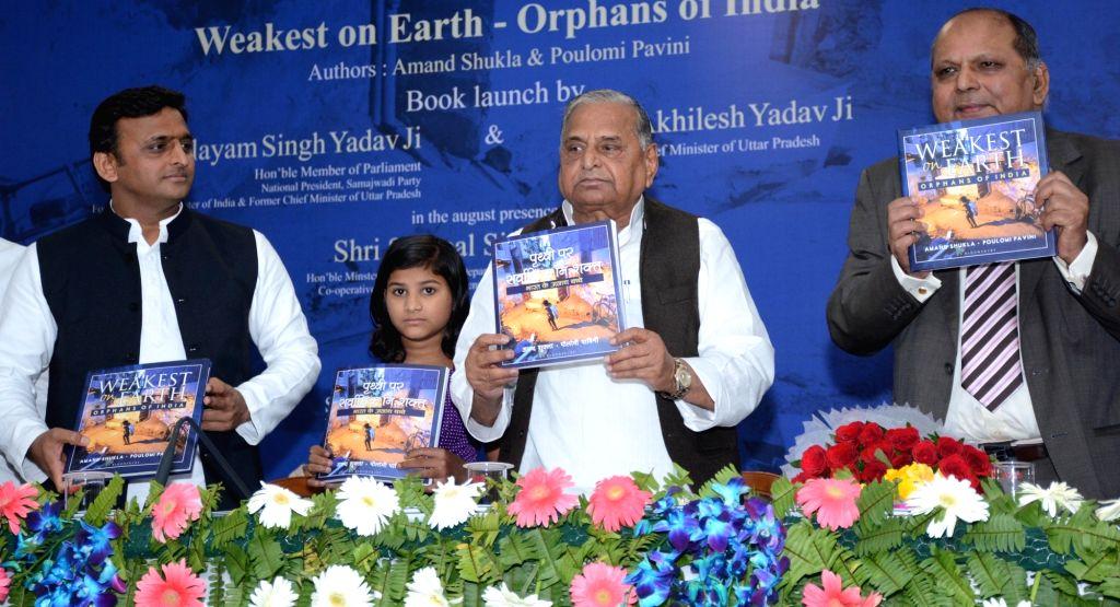 "Uttar Pradesh Chief Minister Akhilesh Yadav and Samajwadi Party supremo Mulayam Singh release ""Weakest on Earth - Orphans of India"" during Children's Day programme in Lucknow, on ... - Akhilesh Yadav and Mulayam Singh"