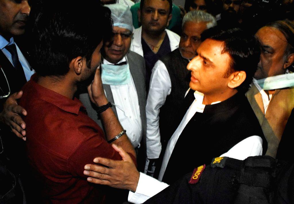 Uttar Pradesh Chief Minister Akhilesh Yadav meets the family members of Principal secretary of Uttar Pradesh's information department Navneet Sehgal who was injured after the ambassador car ... - Akhilesh Yadav