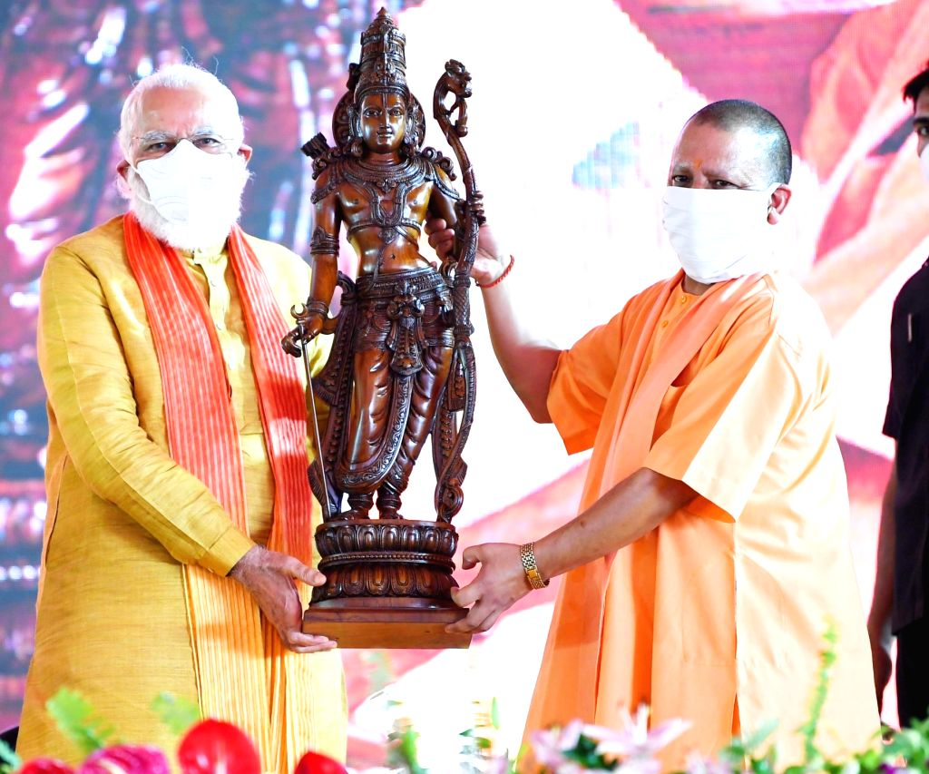"Uttar Pradesh Chief Minister Yogi Adityanath presents an idol of Lord Ram as a memento to honour Prime Minister Narendra Modi during the ""bhumi pujan"" ceremony at the Ram ... - Yogi Adityanath and Narendra Modi"