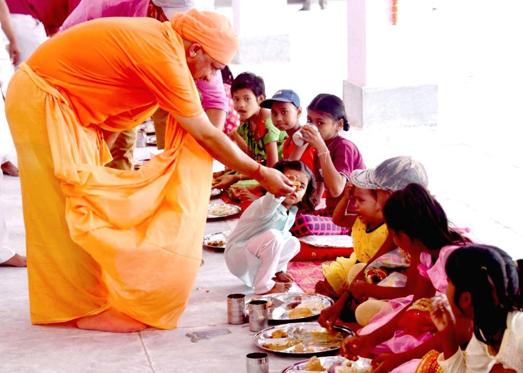 Uttar Pradesh Chief Minister Yogi Adityanath performing Kanya Pujan on the occasion of Maha Navami in Gorakhpur on Thursday October 14,2021 - Yogi Adityanath