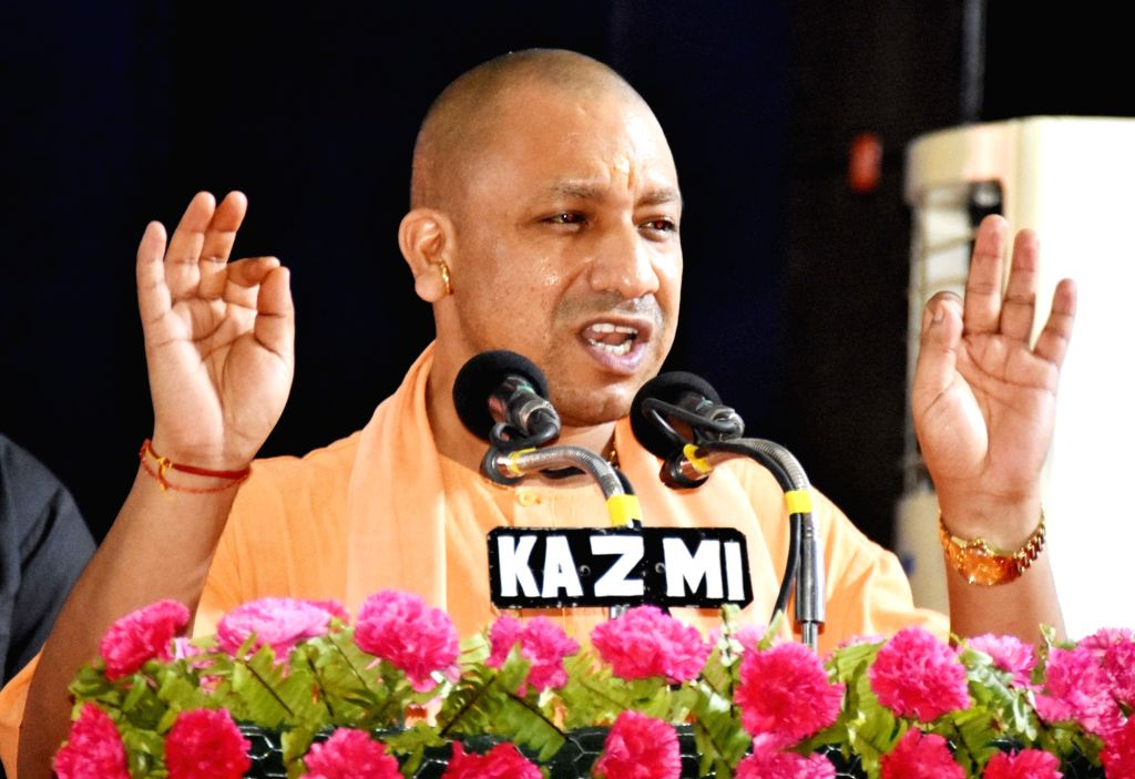 Uttar Pradesh Chief Minister Yogi Adityanath addresses during a programme at Banaras Hindu University in Varanasi on May 27, 2017. - Yogi Adityanath