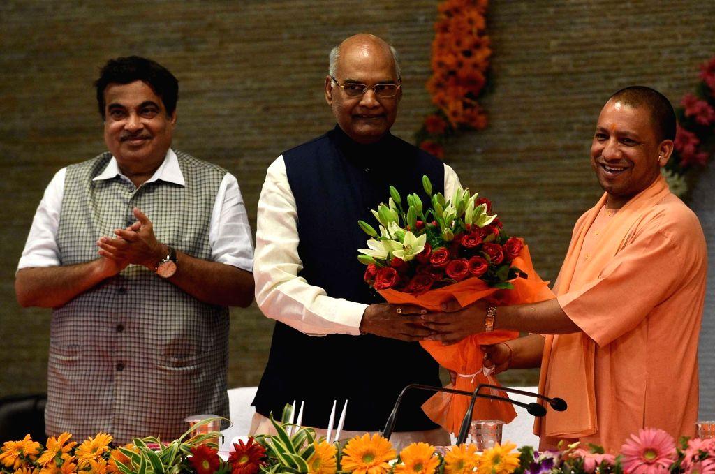 Uttar Pradesh Chief Minister Yogi Adityanath felicitates NDA presidential candidate Ram Nath Kovind in Lucknow on June 25, 2017. Also seen Union Transport Minister Nitin Gadkari. - Yogi Adityanath and Nath Kovind
