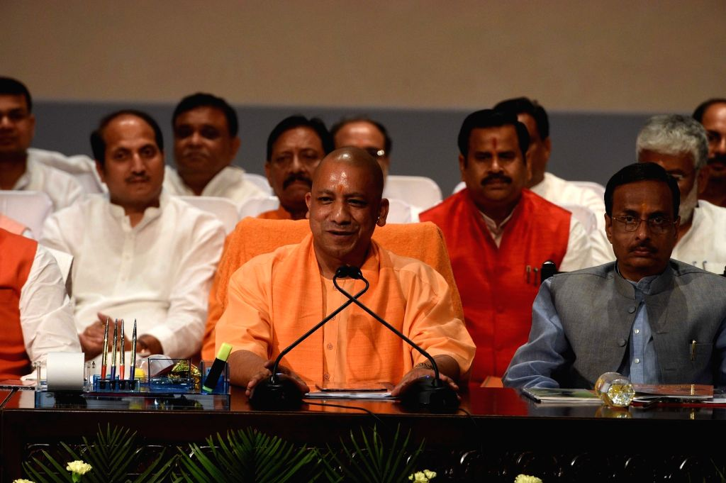Uttar Pradesh Chief Minister Yogi Adityanath addresses a press conference after completing 100 days in office in Lucknow on June 27, 2017. Also seen Uttar Pradesh Deputy Chief Minister ... - Yogi Adityanath and Dinesh Sharma