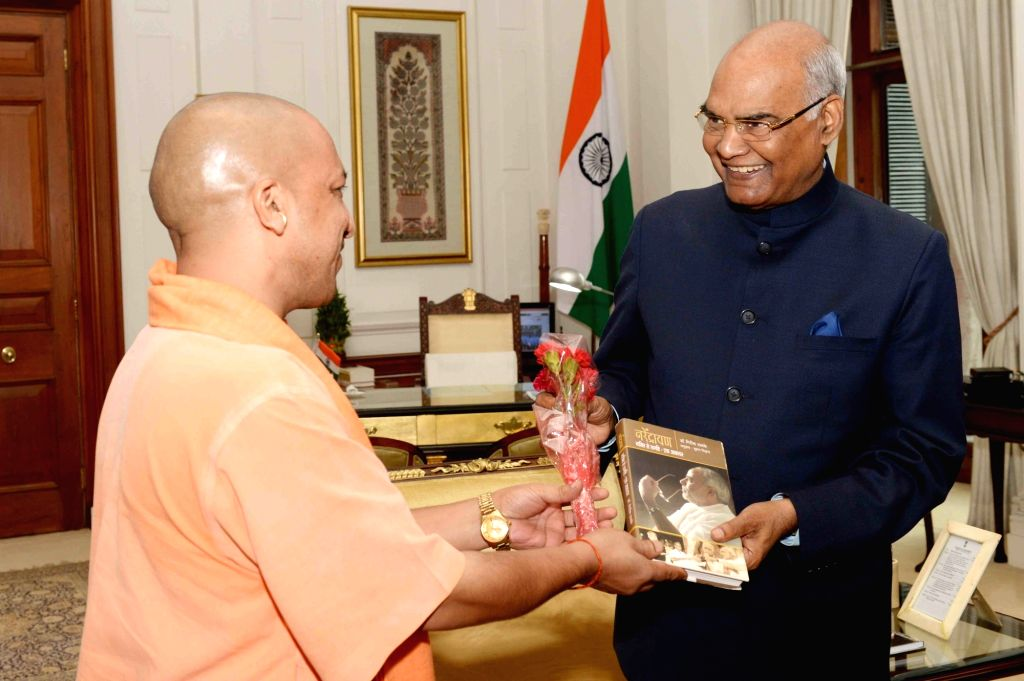 Uttar Pradesh Chief Minister Yogi Adityanath calls on President Ram Nath Kovind at Rashtrapati Bhavan, in New Delhi on Aug 4, 2017. - Yogi Adityanath and Nath Kovind