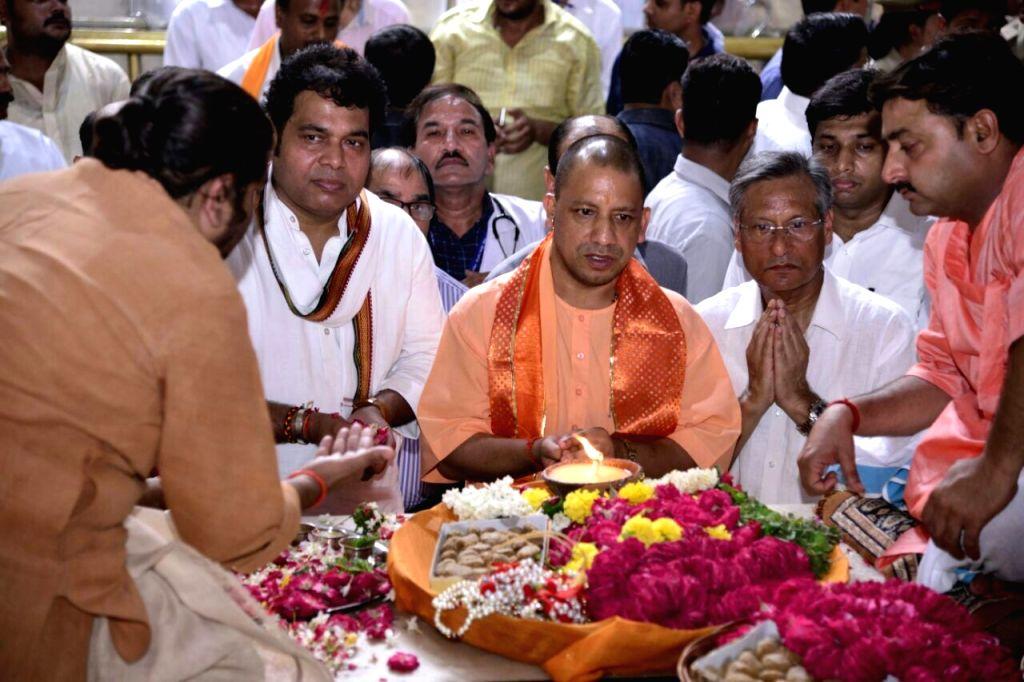 Uttar Pradesh Chief Minister Yogi Adityanath along with UP Power Minister Shrikant Sharma during their visit to Bankey Bihari temple in Vrindavan, Uttar Pradesh on Sept 19, 2017. - Yogi Adityanath and Shrikant Sharma