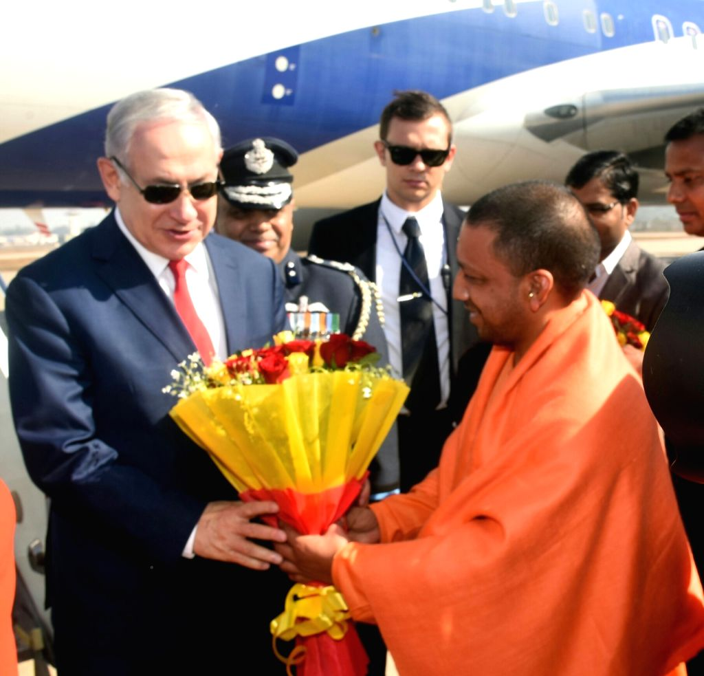 Uttar Pradesh Chief Minister Yogi Adityanath receives Israeli Prime Minister Benjamin Netanyahu on his arrival in Agra on Jan 16, 2018. - Yogi Adityanath