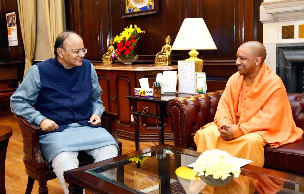 Uttar Pradesh Chief Minister Yogi Adityanath calls on Union Minister for Finance and Corporate Affairs Arun Jaitley in New Delhi on Feb 2, 2018. - Yogi Adityanath and Affairs Arun Jaitley