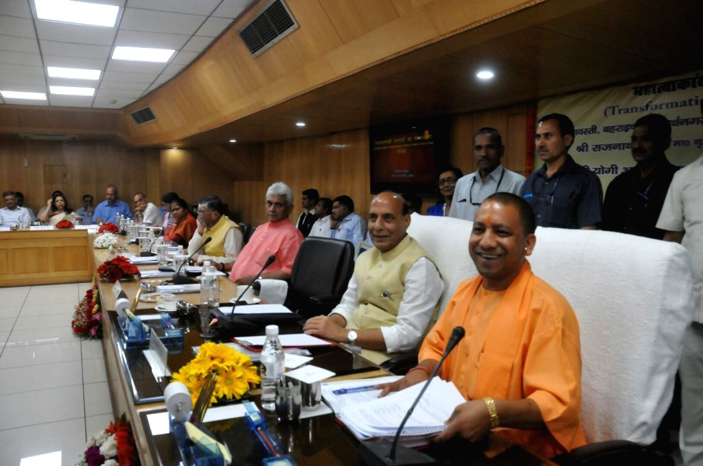 Uttar Pradesh Chief Minister Yogi Adityanath, Union Home Minister Rajnath Singh, Union Communication Minister Manoj Sinha and other ministers during a meeting, in Lucknow on April 9, 2018. - Yogi Adityanath, Rajnath Singh and Manoj Sinha