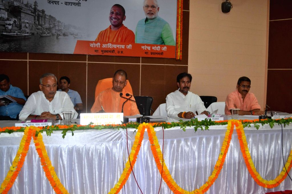 Uttar Pradesh Chief Minister Yogi Adityanath chairs a review meeting on the situation of Law and order in the state, in Varanasi on May 20, 2018. - Yogi Adityanath