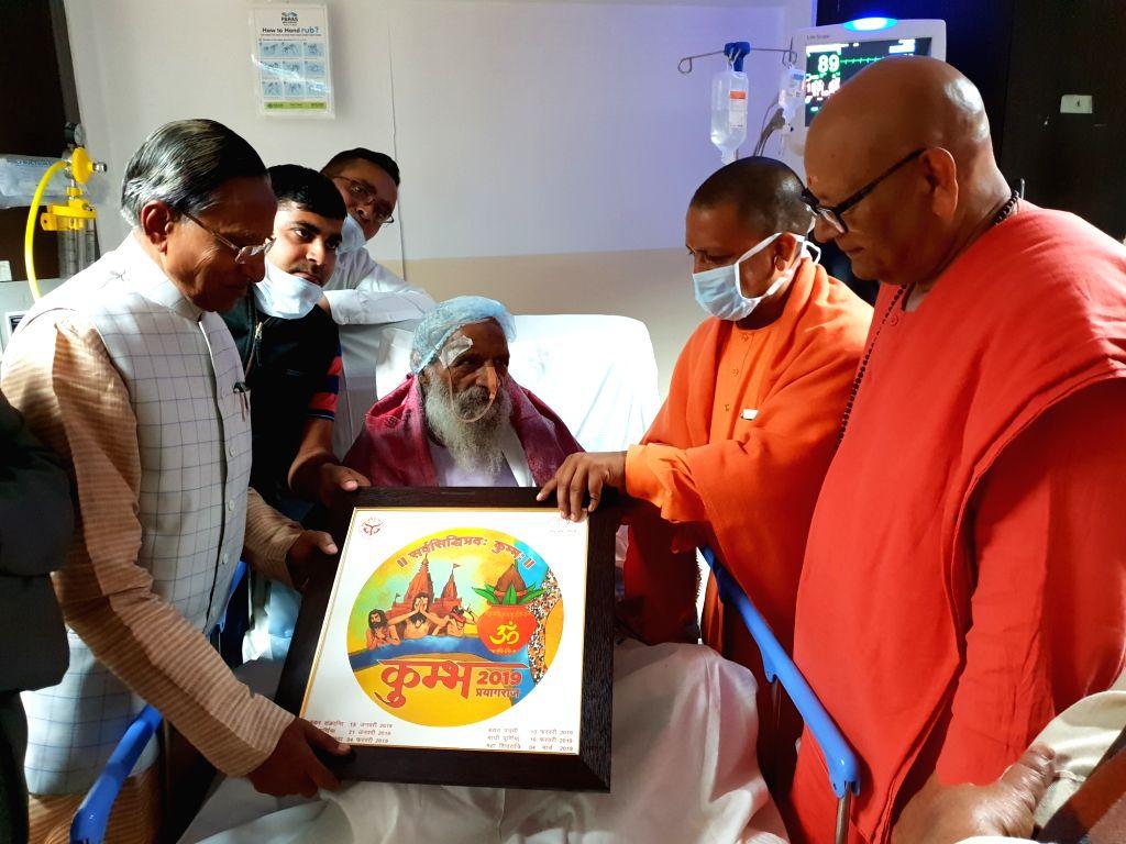 Uttar Pradesh Chief Minister Yogi Adityanath visits Swami Hari Narayan at a Patna hospital on Dec 12, 2018. - Yogi Adityanath