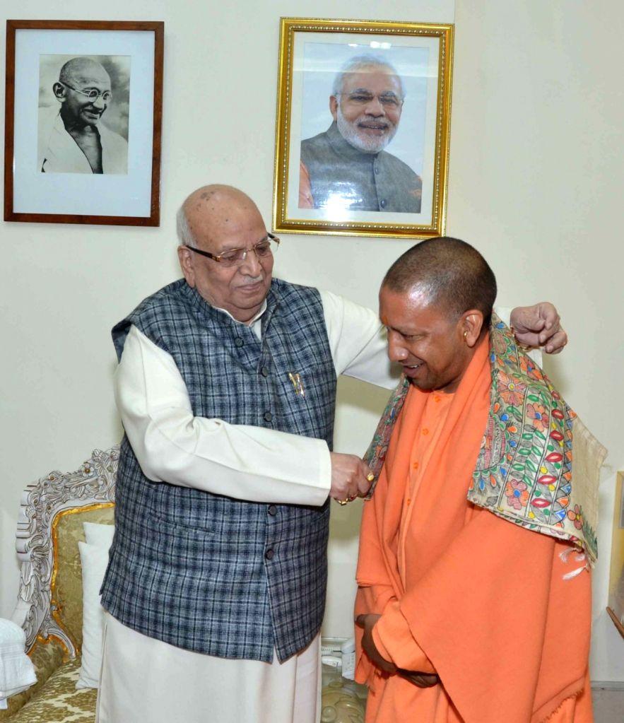 Uttar Pradesh Chief Minister Yogi Adityanath meets Bihar Governor Lalji Tandon at Raj Bhawan in Patna on Dec 13, 2018. - Yogi Adityanath
