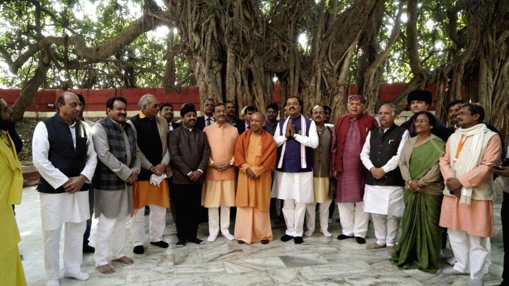 Uttar Pradesh Chief Minister Yogi Adityanath flanked by his deputies Keshav Prasad Maurya and Dinesh Sharma at the cabinet meeting at the sprawling tented complex on the banks of the holy ... - Yogi Adityanath, Dinesh Sharma, Suresh Khanna, Nath Singh, Rita Bahuguna Joshi and Brajesh Pathak