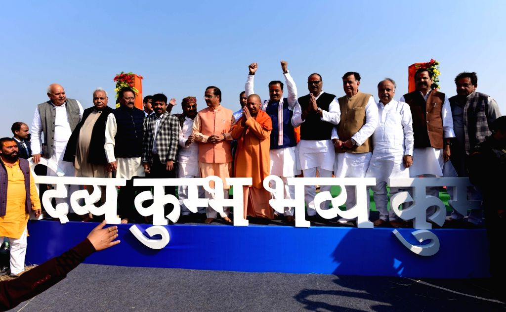 Uttar Pradesh Chief Minister Yogi Adityanath flanked by his deputies Keshav Prasad Maurya and Dinesh Sharma at the cabinet meeting at the sprawling tented complex on the banks of the holy ... - Yogi Adityanath and Dinesh Sharma