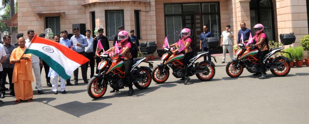 Uttar Pradesh Chief Minister Yogi Adityanath flags off Surat-based three member all women's biking club 'Biking Queens' who will embark on a road trip, in Lucknow on June 3, 2019. The ... - Yogi Adityanath