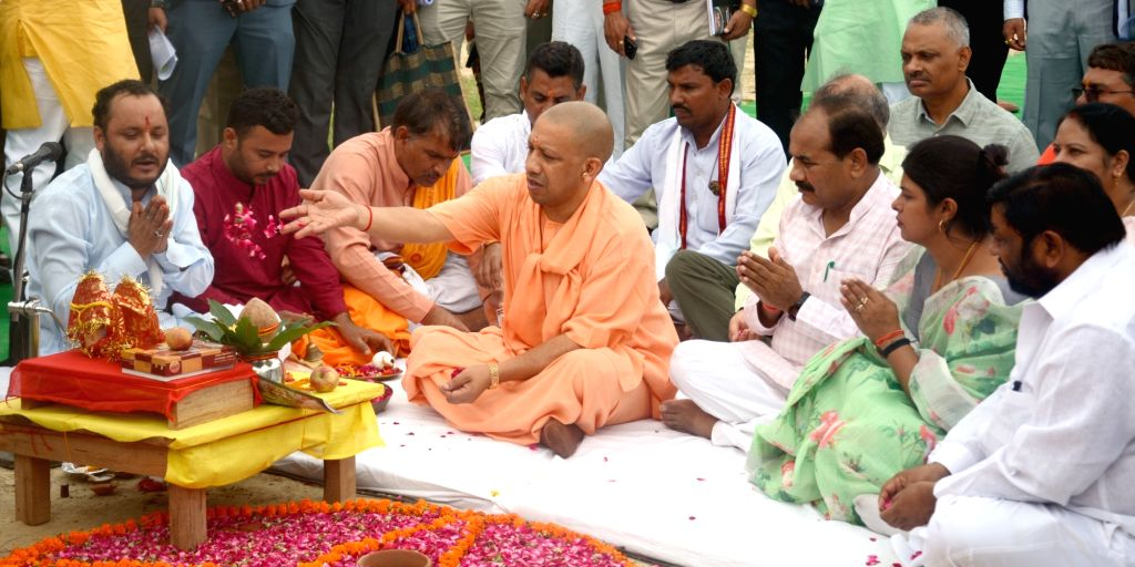 Uttar Pradesh Chief Minister Yogi Adityanath performs rituals at the inauguration of a massive plantation drive in Jaiti Khera village of Lucknow, on Aug 9, 2019. The state government plans ... - Yogi Adityanath
