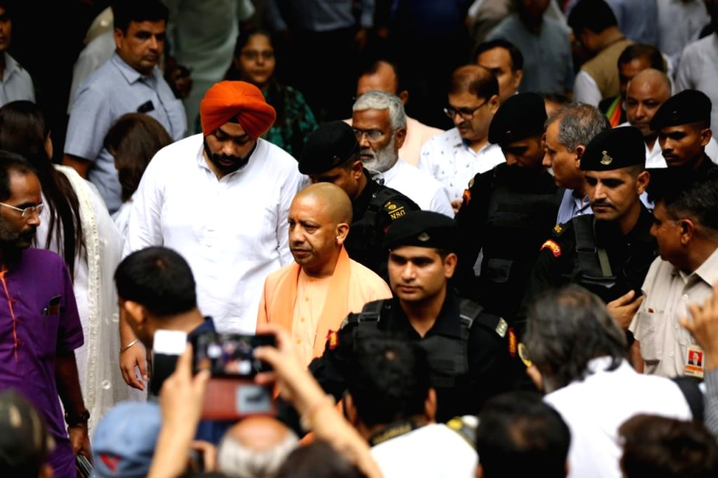 Uttar Pradesh Chief Minister Yogi Adityanath arrives to pay tribute to Former Finance Minister Arun Jaitley at his residence, in New Delhi on Aug 24, 2019. - Yogi Adityanath and Arun Jaitley