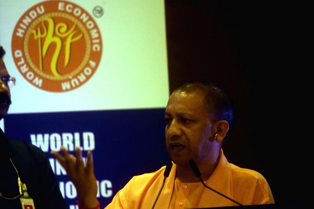 Uttar Pradesh Chief Minister Yogi Adityanath addresses during a session on World Hindu Economic Forum (WHEF) in Mumbai on Sep 27, 2019. - Yogi Adityanath