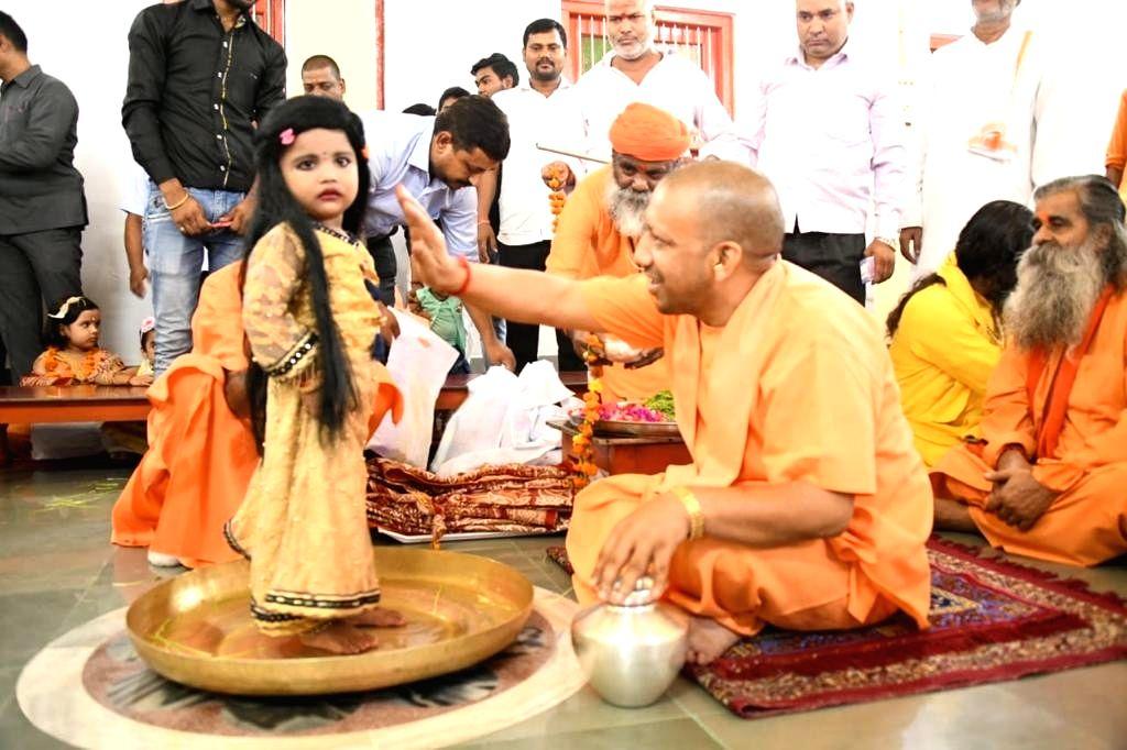 Uttar Pradesh Chief Minister Yogi Adityanath performs 'Kanya Pujan' on the occasion of  'Mahanavami' at Gorakhnath Temple in Uttar Pradesh's Gorakhpur, on Oct 7, 2019. - Yogi Adityanath