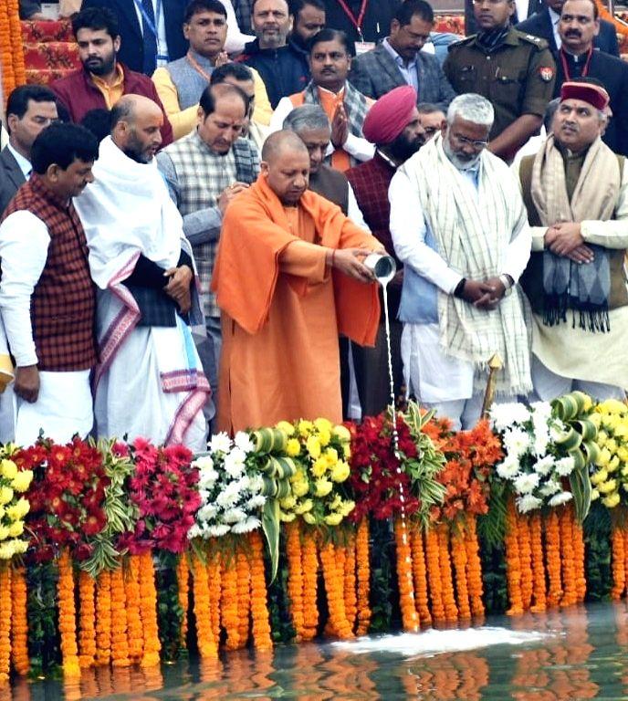 Uttar Pradesh Chief Minister Yogi Adityanath performs rituals on the banks of Ganga river before embarking on the five-day Ganga Yatra under the 'Namami Ganga' campaign, in Bijnor on Jan 27, ... - Yogi Adityanath