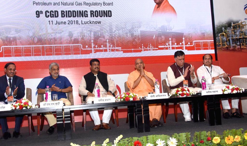 Uttar Pradesh Chief Minister Yogi Adityanath and Union Petroleum Minister Dharmendra Pradhan during 9th City Gas Distribution (CGD) Bidding Round, in Lucknow on June 11, 2018. - Yogi Adityanath