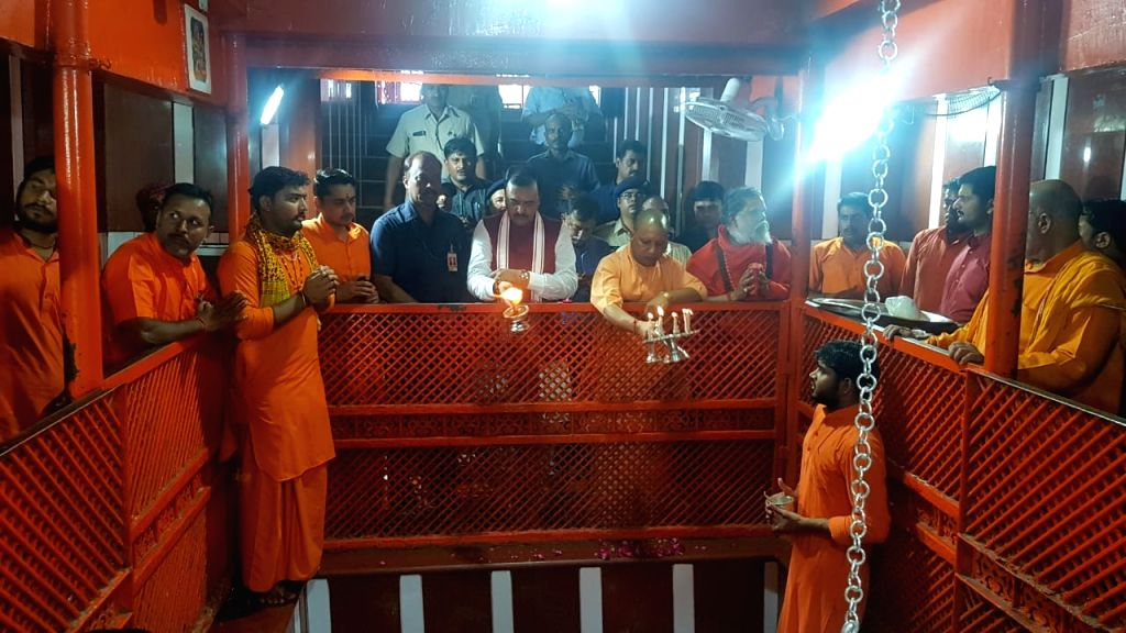Uttar Pradesh Chief Minister Yogi Adityanath and Deputy Chief Minister Keshav Prasad Maurya perform 'Aarti' at Bade Human Temple at Sangam in Prayagraj on Aug 9, 2019. - Yogi Adityanath