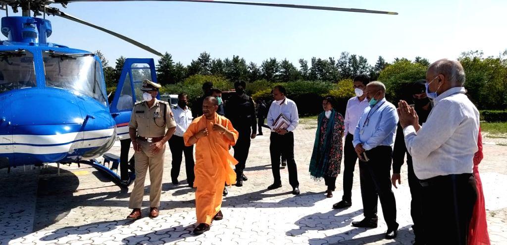 Uttar Pradesh Chief Minister Yogi Adityanath arrives in Noida on Monday. (Photo: Sanjeev Kumar Singh Chauhan/IANS) - Yogi Adityanath