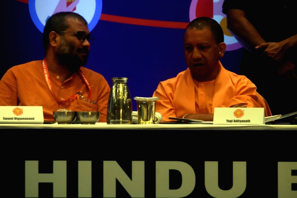 Uttar Pradesh Chief Minister Yogi Adityanath in a conversation with World Hindu Economic Forum (WHEF) Founder Swami Vigyananand during a three-day conference in Mumbai on Sep 27, 2019. - Yogi Adityanath