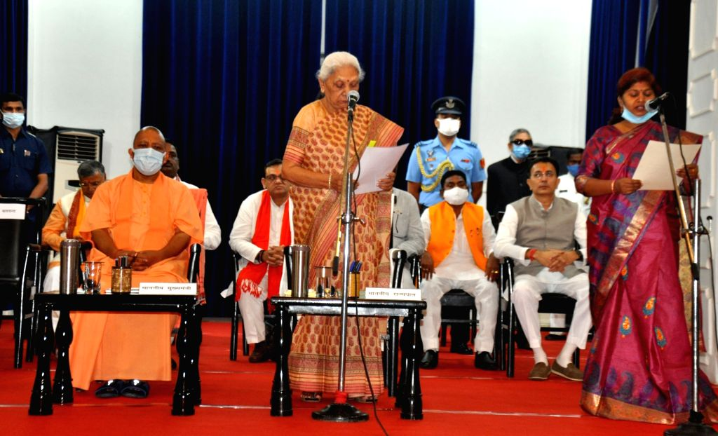 Uttar Pradesh Chief Minister Yogi Adityanath on Sunday expanded his cabinet by inducting seven new ministers. All the new ministers were administered oath of office and secrecy by Governor Anandiben ... - Yogi Adityanath and Anandiben Patel