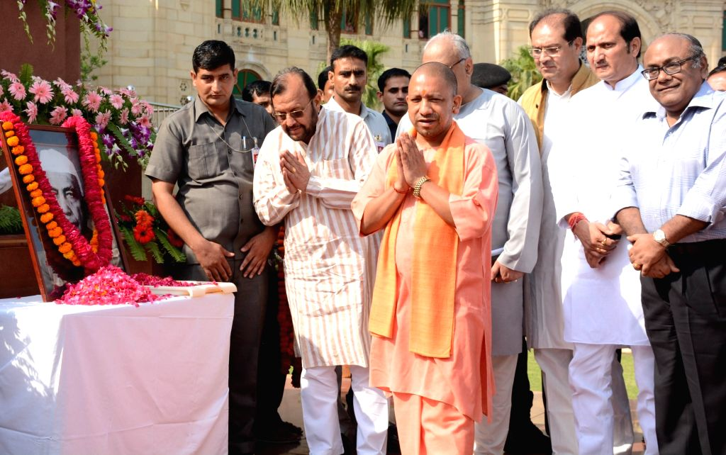 Uttar Pradesh Chief Minister Yogi Adityanath pays tribute to Chaudhary Charan Singh in Lucknow, on May 29, 2017. - Yogi Adityanath and Chaudhary Charan Singh