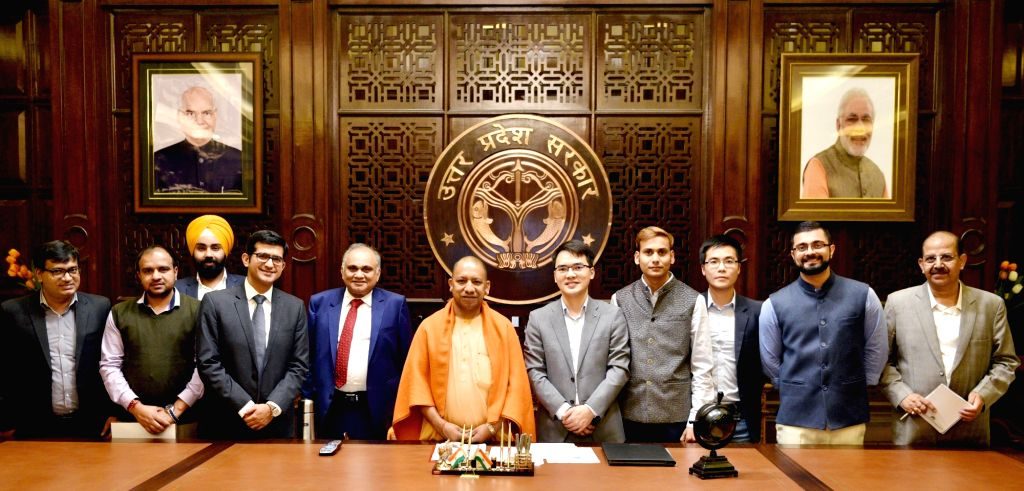 Uttar Pradesh Chief Minister Yogi Adityanath with officials of Chinese smartphone maker Vivo, that on Thursday announced an additional investment of Rs 4,000 crore for over a period of ... - Yogi Adityanath
