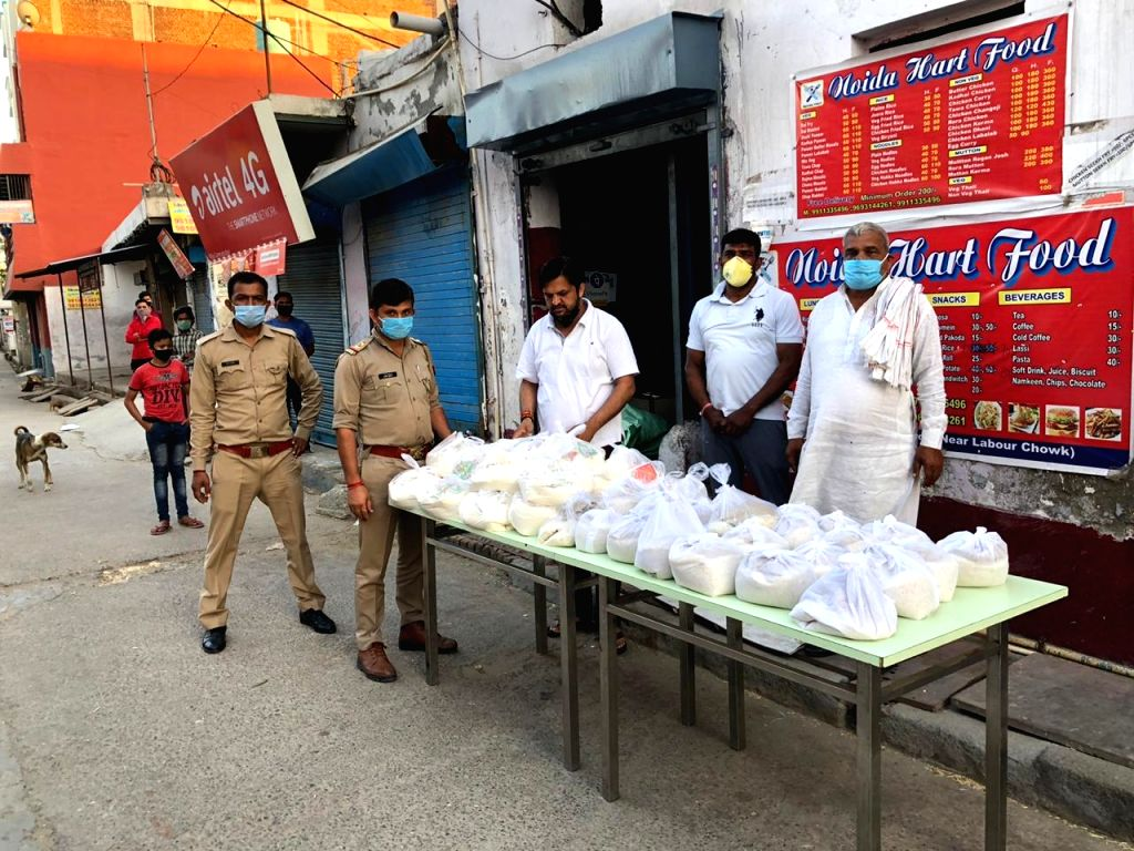 Uttar Pradesh Congress Committee Member Ram Kumar Tanwar dispatches food packages and distributes food among the needy and the poor amid lockdown imposed across the nation to contain the spread of ...