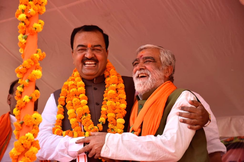Uttar Pradesh Deputy Chief Minister Keshav Prasad Maurya and BJP's Lok Sabha candidate from Buxar, Ashwini Kumar Chaubey during a public rally, in Patna, on May 12, 2019. - Keshav Prasad Maurya and Ashwini Kumar Chaubey