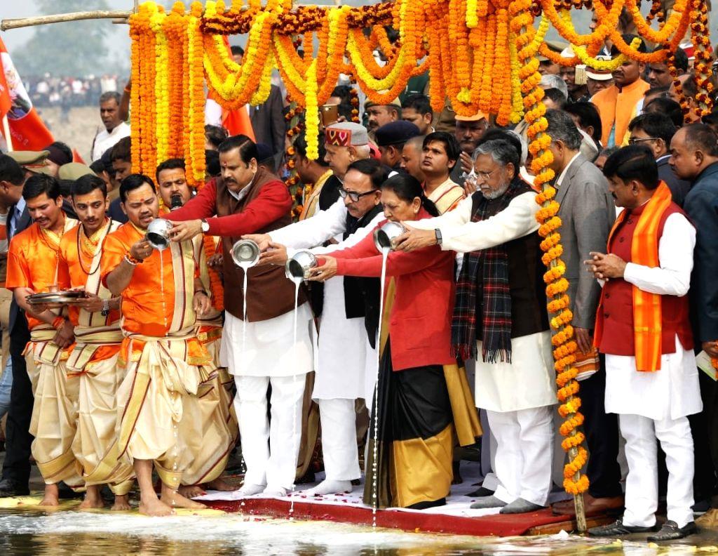Uttar Pradesh Governor Anandiben Patel and Bihar Deputy Chief Minister Sushil Kumar Modi perform rituals on the banks of the Ganga river at the flagging off ceremony of the five-day Ganga ... - Sushil Kumar Modi and Anandiben Patel