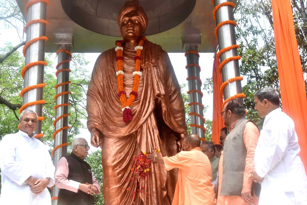 Uttar Pradesh Governor Ram Naik and Chief Minister Yogi Adityanath pay tributes to Swami Vivekananda at the inauguration of his statue, in Lucknow on July 17, 2019. - Yogi Adityanath