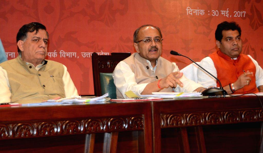 Uttar Pradesh Minister Siddharth Nath Singh addresses a press conference in Lucknow on May 30, 2017. - Siddharth Nath Singh