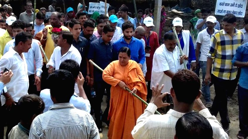 Uttar Pradesh: Union Minister for Drinking Water and Sanitation Uma Bharti participates in the cleanliness drive at the 'Swachhta Hi Sewa' campaign in Uttar Pradesh on Sept 17, 2017.