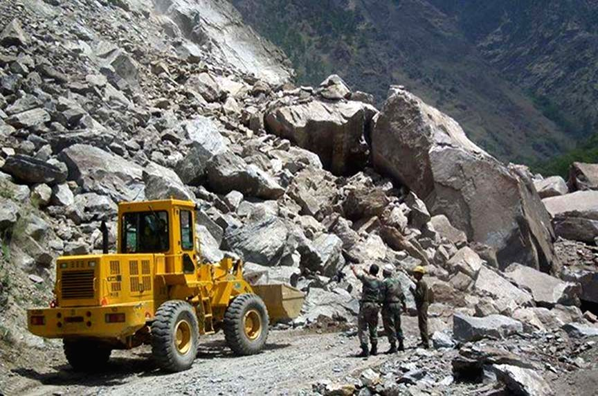 An earth-mover deployed to remove the boulders from Rishikesh-Badrinath Highway after a landslide in Uttarakhand on April 30, 2015.