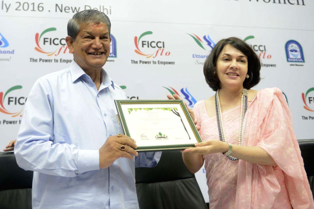 "Uttarakhand Chief Minister Harish Rawat being and FLO President Vinita Bimbhet during an Interactive Session on ""Uttarakhand: The Next Investment Destination for Women"" at FICCI ... - Harish Rawat"