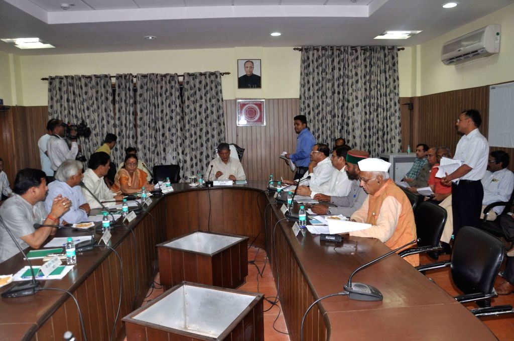 Uttarakhand Chief Minister Harish Rawat during his first cabinet meeting after Uttarakhand High Court set aside President's Rule in the state, restoring him as the chief minister, nearly a ... - Harish Rawat