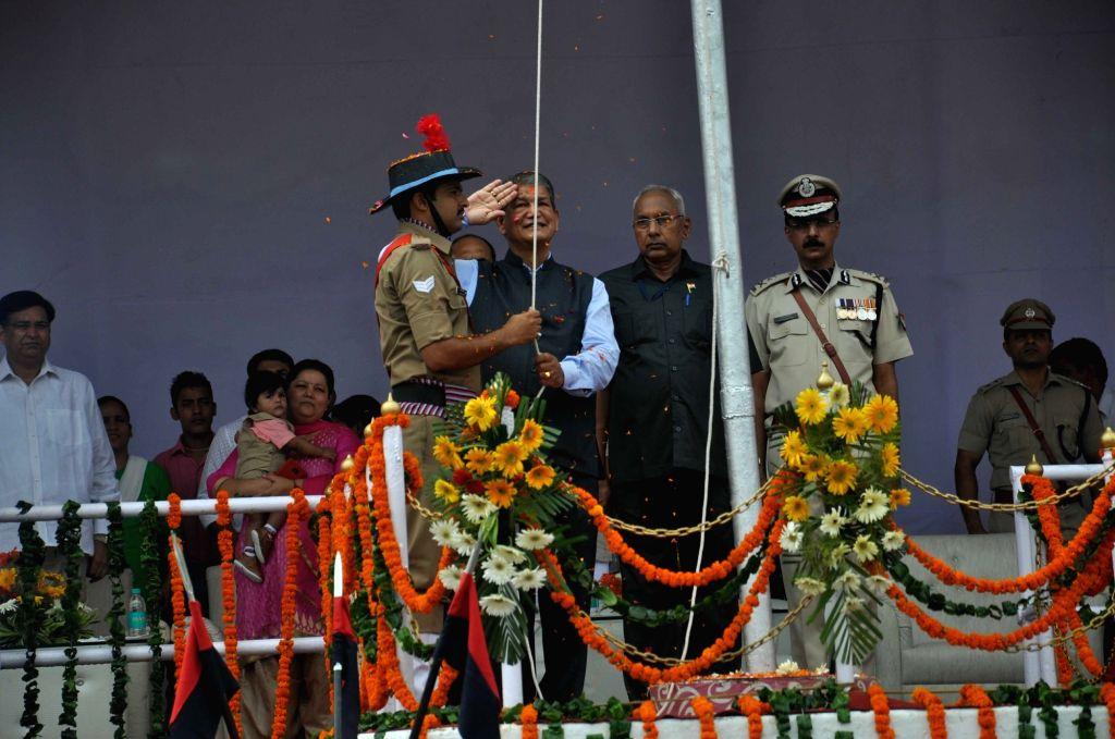 Uttarakhand Chief Minister Harish Rawat hoists the national flag on Independence Day in Dehradun on Aug 15, 2016. - Harish Rawat