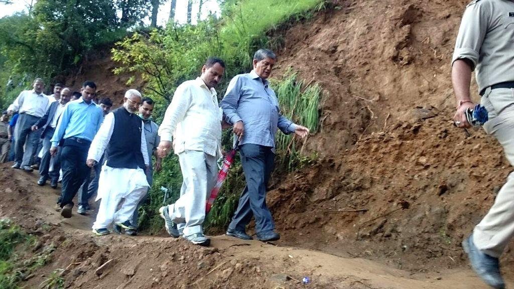 Uttarakhand Chief Minister Harish Rawat visits the villages affected by landslides and cloudburst in Uttarakhand's Pithoragarh on July 5, 2016. - Harish Rawat