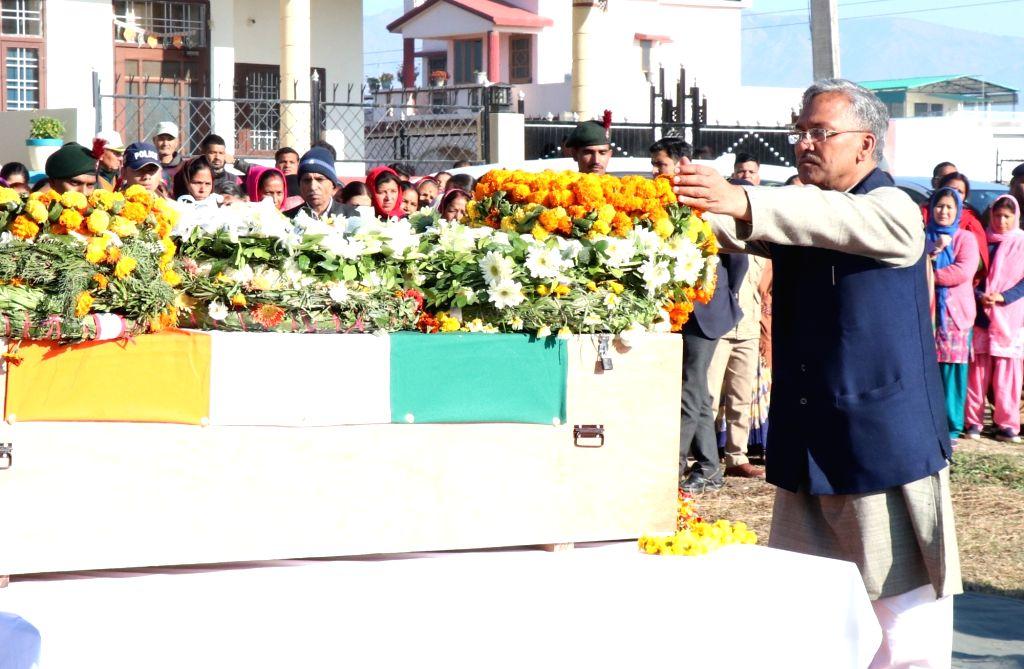 Uttarakhand Chief Minister T.S. Rawat lays wreath on the mortal remains of martyr Rakesh Raturi who was killed on 10th Feb Sunjwan army camp terror attack, in Dehradun on Feb 14, 2018. - T.