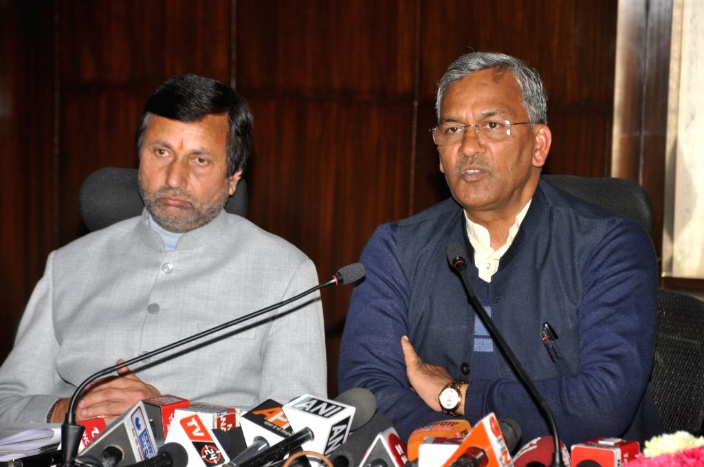 Uttarakhand Chief Minister Trivendra Singh Rawat accompanied by Finance Minister Prakash Pant, addresses a press conference regarding the interim budget 2019 in Dehradun, on Feb 1, 2019. - Trivendra Singh Rawat