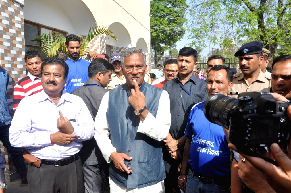 Uttarakhand Chief Minister Trivendra Singh Rawat showing his inked finger after casting his vote for Lok Sabha election in Dehradun on April 11, 2019. - Trivendra Singh Rawat