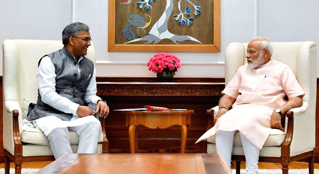 Uttarakhand Chief Minister Trivendra Singh Rawat calls on Prime Minister Narendra Modi, in New Delhi on June 3, 2019. - Trivendra Singh Rawat and Narendra Modi