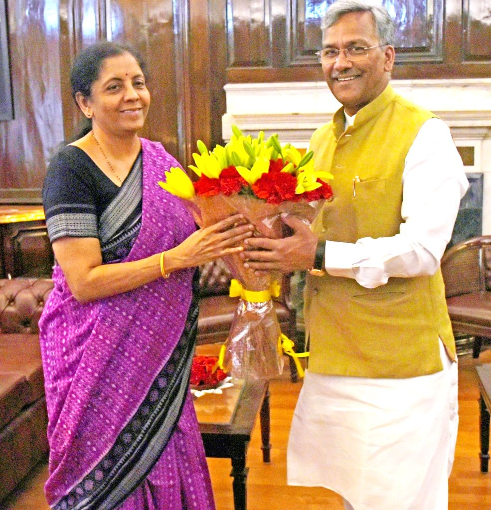 Uttarakhand Chief Minister Trivendra Singh Rawat meets Union Finance and Corporate Affairs Minister Nirmala Sitharaman, in New Delhi on June 15, 2019. - Trivendra Singh Rawat