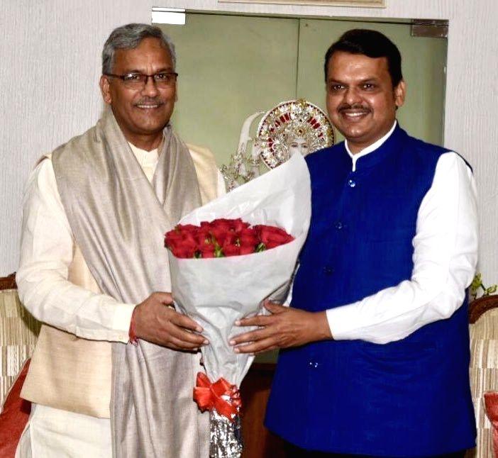 Uttarakhand Chief Minister Trivendra Singh Rawat meets Maharashtra Chief Minister Devendra Fadnavis in Mumbai on Sep 21, 2019. - Trivendra Singh Rawat