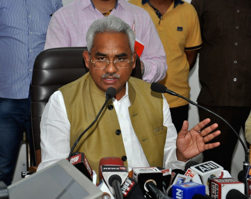 Uttarakhand Urban Development Minister Madan Kaushik addresses a press conference in Dehradun on May 20, 2017. - Madan Kaushik
